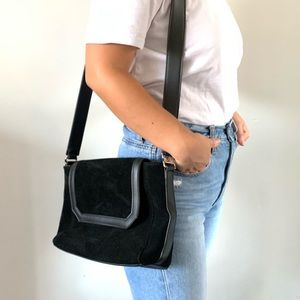 Urban Outfitters black suede strap bag